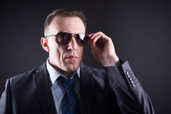 Confident businessman in sunglasses Stock Photography