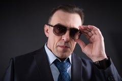 Confident businessman in sunglasses Stock Image