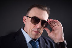 Confident businessman in sunglasses Stock Images