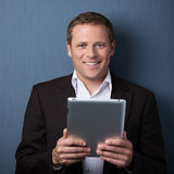 Confident businessman with a tablet-pc Stock Photo