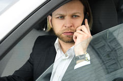 Confident businessman talking on the mobile phone and looking aw Royalty Free Stock Photography