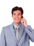 Confident businessman talking on phone Stock Photo