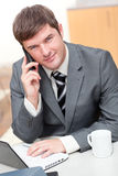 Confident businessman talking on phone Stock Photos