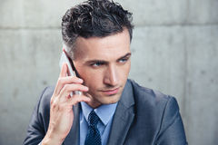 Confident businessman talking on the phone Royalty Free Stock Photo