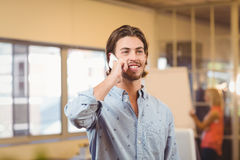 Confident businessman talking on phone Stock Image