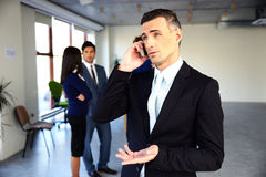 Confident businessman talking on the phone Royalty Free Stock Photography