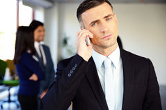 Confident businessman talking on the phone Stock Image