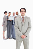 Confident businessman with team behind him Stock Photography