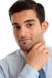 Confident businessman thinking Stock Photo