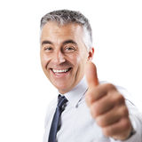Confident businessman thumbs up Stock Photography
