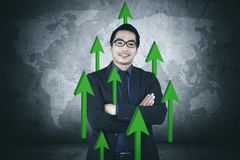 Confident businessman with upward arrows Stock Photos