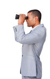 Confident businessman using binoculars Royalty Free Stock Photography