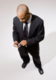 Confident businessman using electronic organizer Stock Photography