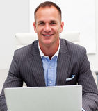 Confident businessman using a laptop Stock Photo