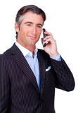 Confident businessman using a mobile phone Royalty Free Stock Photography