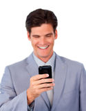 Confident businessman using a mobile phone Royalty Free Stock Photos