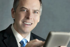 Confident Businessman Using Tablet Stock Photography