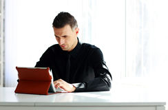 Confident businessman using tablet computer Royalty Free Stock Photo