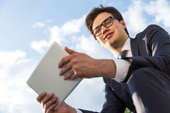 Confident businessman using tablet outside Stock Image
