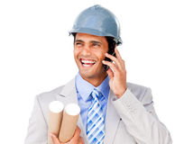 Confident businessman wearing a hardhat on phone Royalty Free Stock Photography