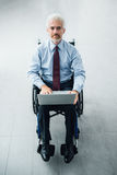 Confident businessman in wheelchair Stock Image
