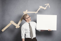 Confident businessman with white empty panel. Royalty Free Stock Image