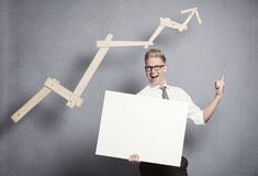 Confident businessman with white empty panel pointing up. Royalty Free Stock Images