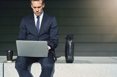 Confident businessman while work with his laptop Stock Photos