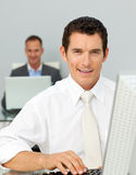 Confident businessman working at his computer Royalty Free Stock Image