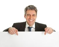 Confident businessmen presenting empty board Stock Image