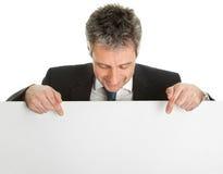 Confident businessmen presenting empty board Stock Photo
