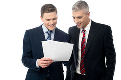 Confident businessmen reviewing records Royalty Free Stock Photo