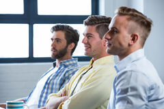 Confident businessmen sitting in creative office Royalty Free Stock Photo