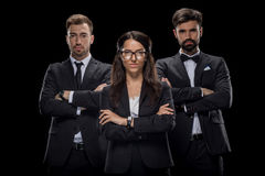 Confident businesspeople with crossed arms looking at camera stock photography