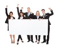 Confident businesspeople holding blank banner Royalty Free Stock Images