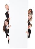 Confident businesspeople holding blank banner Stock Image
