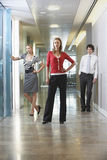 Confident Businesspeople In Office Corridor Royalty Free Stock Images