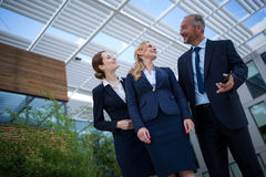 Confident businesspeople standing in the office premises Stock Photography