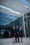 Confident businesspeople standing in the office premises. Portrait of confident businesspeople standing in the office premises Stock Photos