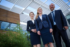 Confident businesspeople standing in the office premises. Portrait of confident businesspeople standing in the office premises Royalty Free Stock Photography
