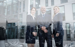 Confident businesspeople standing in office premises. Portrait of confident businesspeople standing in office premises Royalty Free Stock Image