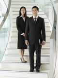 Confident Businesspeople Standing On Staircase Royalty Free Stock Images