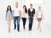 Confident businesspeople walking together Stock Photography