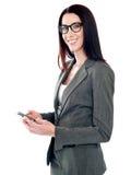 Confident businessperson messaging Stock Photos