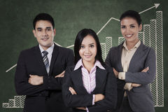 Confident businessteam with graph Stock Photography