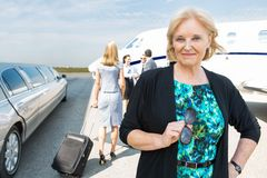 Confident Businesswoman Against Private Jet Royalty Free Stock Photography