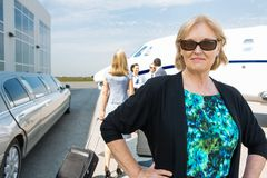 Confident Businesswoman Against Private Jet Royalty Free Stock Images