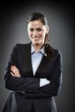 Confident businesswoman with arms folded Stock Photo
