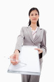 Confident businesswoman asking for signature Stock Image