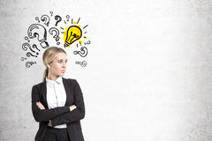 Confident businesswoman, bulb and questions stock images
